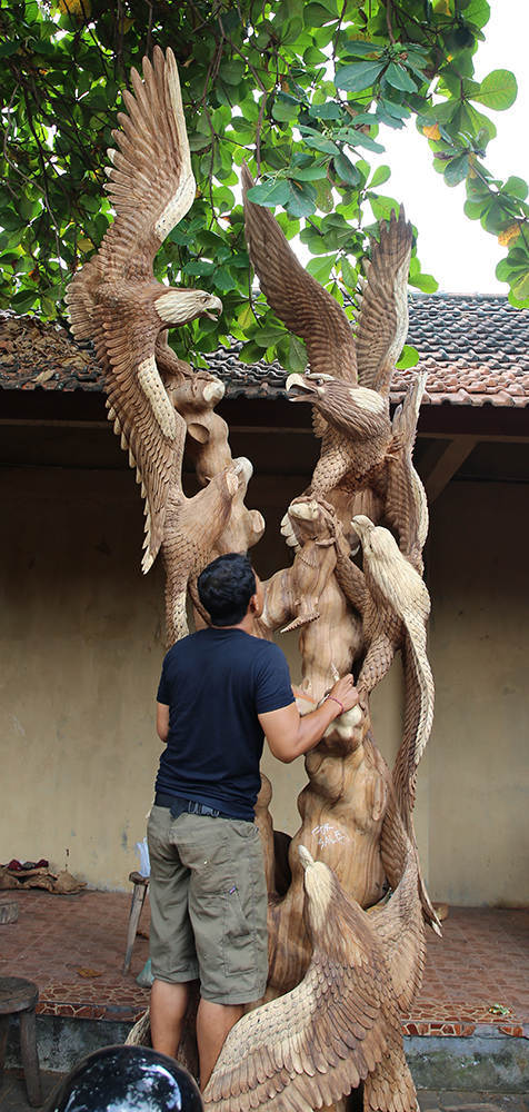 huge sculpture made out of suar wood