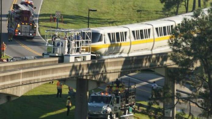 Emergency crews begin to evacuate a monorail that is stuck on the tracks at Walt Disney World. (@irishguynweho, via Twitter)