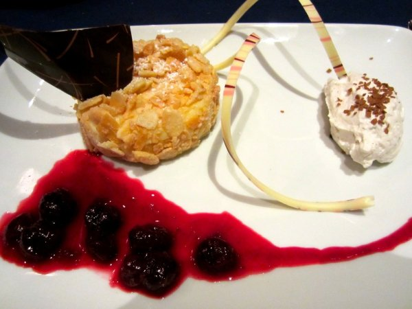 Grand Floridian Recipe Almond-crusted Cheesecake served with Lambert cherry sauce - Narcoossees