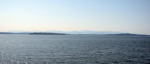 Vashon ferry commute heading west toward the Olympics