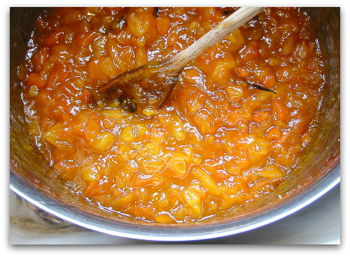 apricot jam simmering on the stove