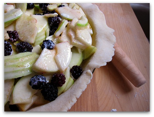 pie dough apple and blackeberries rolling pin