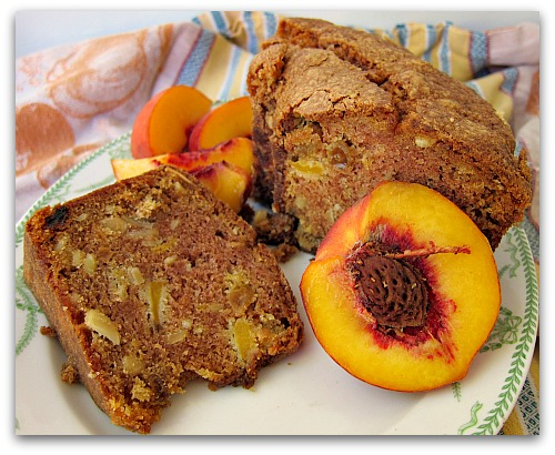fresh peach cake sliced on a plate