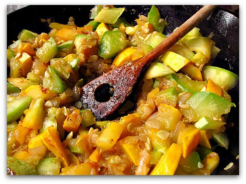 sauteed summer squash in a cast iron pan