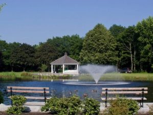 Park with gazeebo, pond, and trees