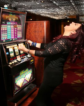 lady playing in a casino