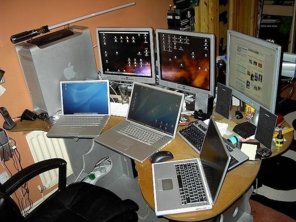 This is the old desk for the Tame Geek Including a Custom built PC Gaming Rig, A PowerMac G5, Three PowerBooks an iPod, Palm Pilot Tungsten and a lightsabre