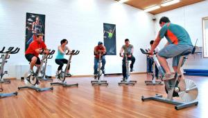 men-and-women-cycling-in-gym-bike