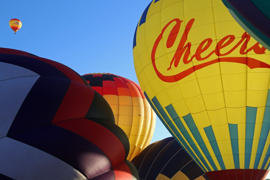 inflating baloons for mass ascension Reno Hot Air Baloon Race