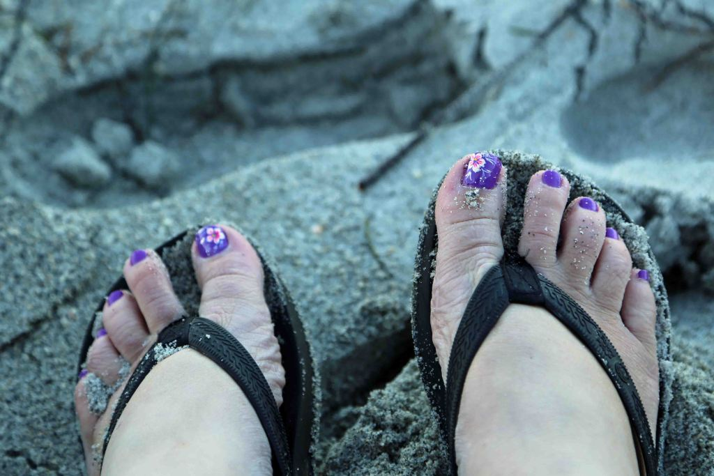 Feet in the sand at Sanibel Island Florida