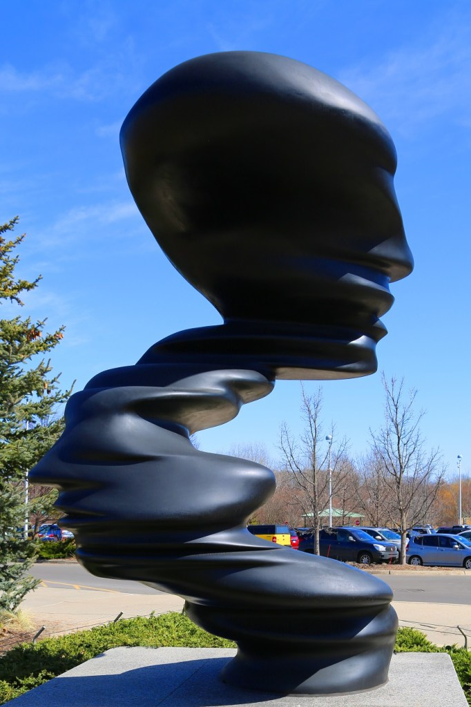 Sculpture in parking lot at Sculpture Garden Park Grand Rapids