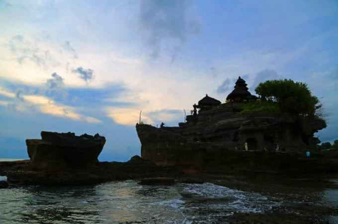 Visiting Tanah Lot in Bali at sunset