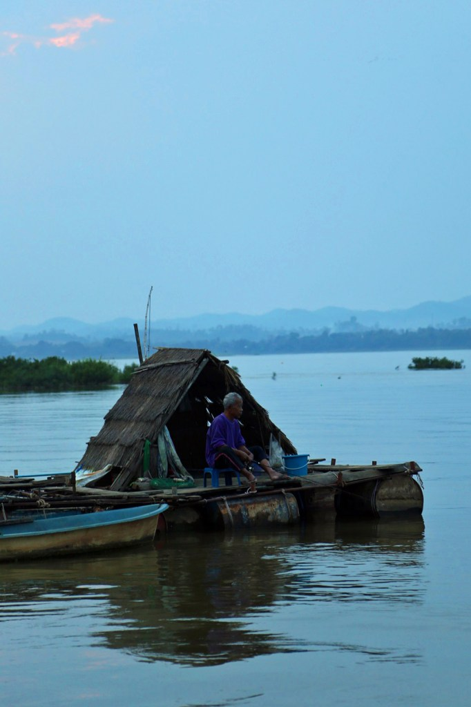 fisherman on the Mekong River