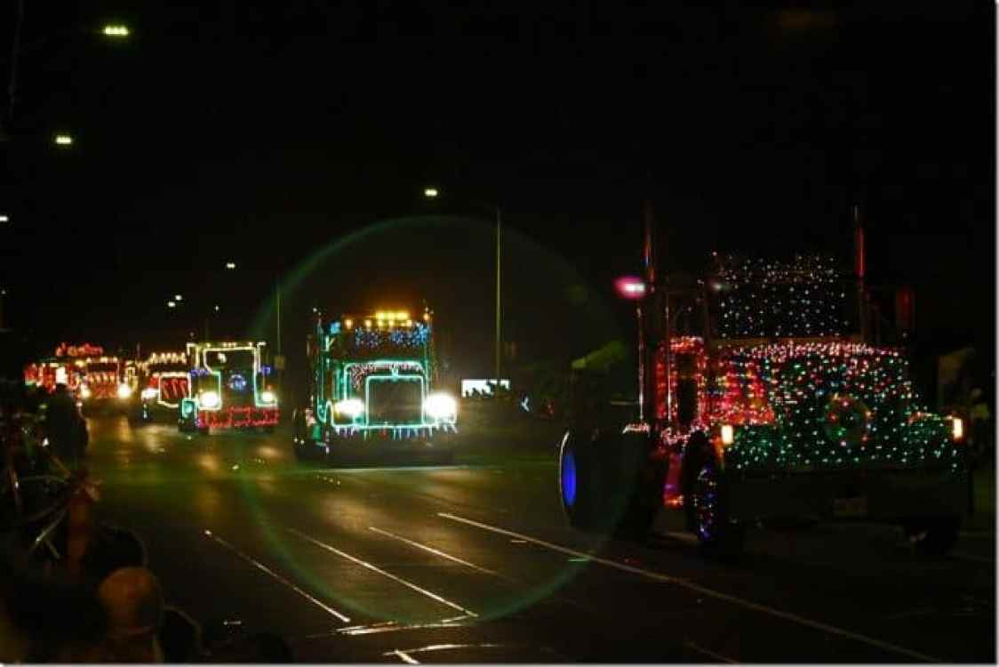 Semi Trucks lined up all decorated coming downmain street in Waimea Christmas Parade
