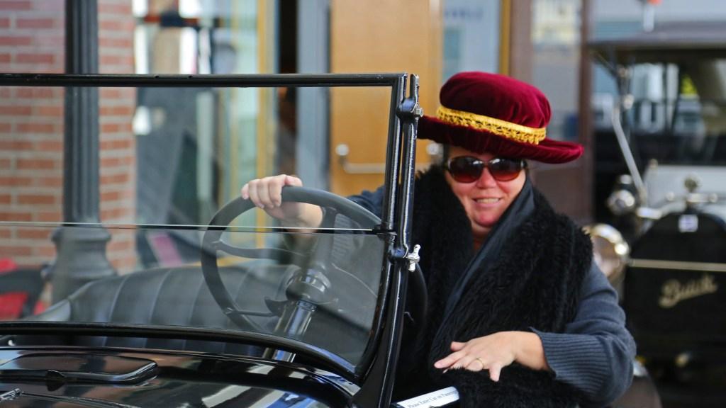 Tammilee in car at Reno Auto Museum