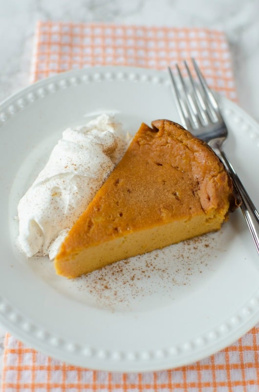 Super Easy Crock Pot Pumpkin Pie Pudding Cake! This dessert recipe is perfect for Fall, Thanksgiving, Christmas or any day you need a sweet treat. The slow cooker does all the work and you get a delicious cake to serve to your family!  #pumpkin #fall #harvest #psl #pumpkinpie #cake #pudding #dessert #pumpkinspice #holiday #halloween
