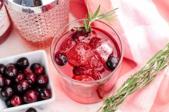 Spiced Cranberry Cocktail Recipe is perfect for Valentine's Day or any holiday. Pin it now for Christmas next year! This vodka cocktail is the perfect holiday drinks recipe!