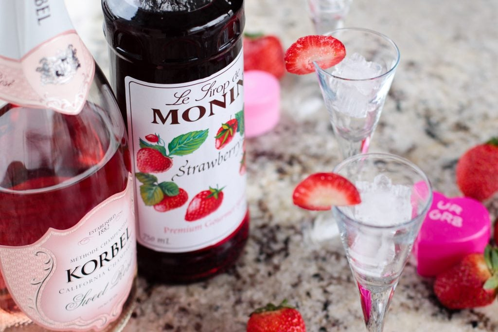 Easy to make Strawberry Rosé Champagne Cocktail Recipe is perfect for Valentines Day, Girls night in, bunko night parties, and so much more!