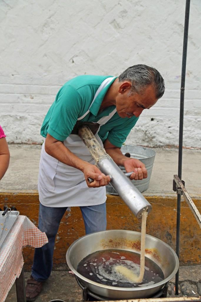 putting-churro-dough-in-greese-in-puerto-vallarta-mexico