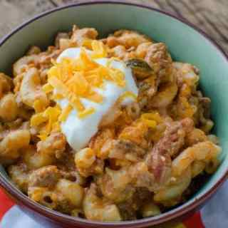 Easy Cheesy Crockpot Slow Cooker Taco Beef Pasta Recipe is going to be come a family favorite! The crock pot does all the work and you have a delicious family meal.