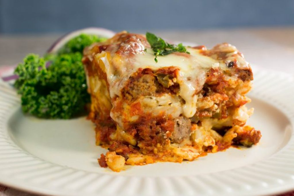 Easy Slow Cooker Crock Pot Lasagna Recipe the entire family will love. Ground beef, cheese, pasta combined to make the perfect Italian comfort food recipe.