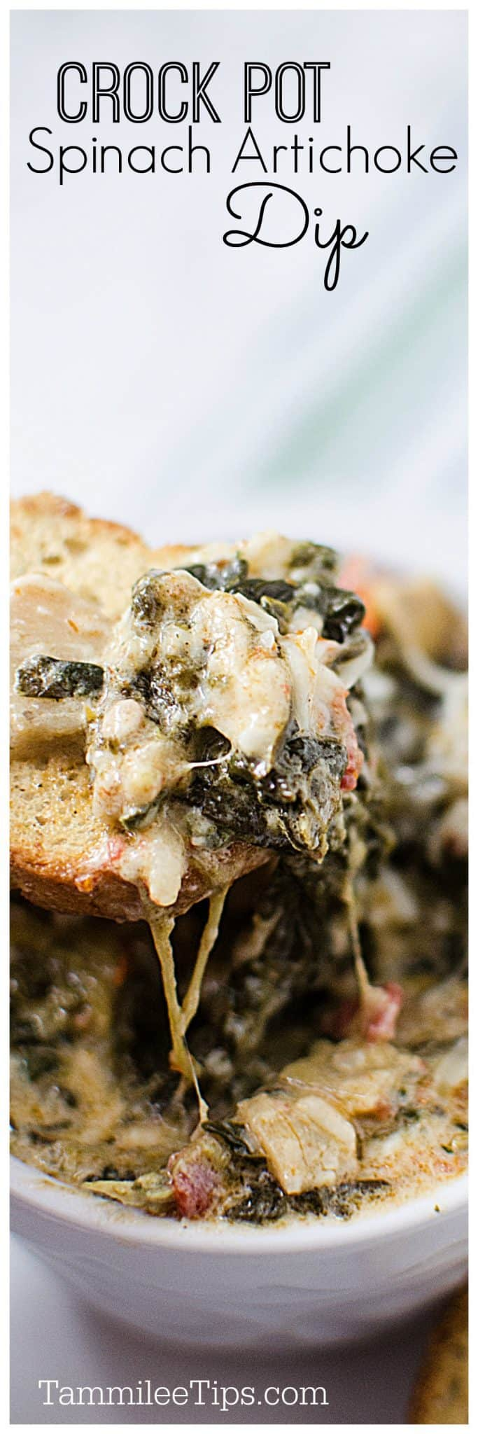Slow Cooker Crock Pot Spinach Artichoke Dip with sun-dried tomatoes and artichokes. Perfect for holiday parties, football super bowl parties and more! So easy to make #SuperBowl #holidayparties #parties #dip #slowcooker #crockpot