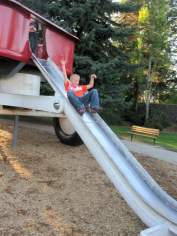 Sliding down the red wagon in Spokane Riverfront Park