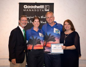 (From l to r) Goodwill Manasota president and CEO Bob Rosinsky, Business 100 members Cynthia and Tim Holiday of Children's World Uniform and Supply, and Goodwill Manasota vice president Veronica Brandon Miller