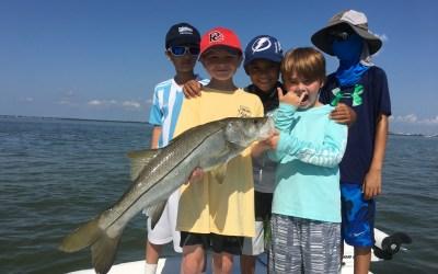 Take a kid fishing this summer