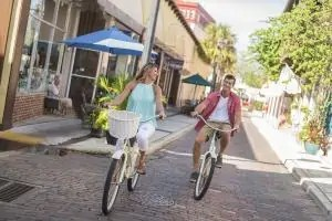 A couple riding bicycles along the historic streets of St. Augustine