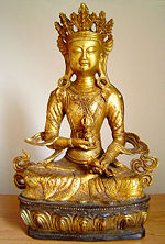 Vajrasattva holds the vajra in his right hand and a bell in his left hand.