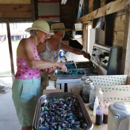 "Lucy and Tanya are dyeing more wool in Lucy's dyeing ""kitchen."""