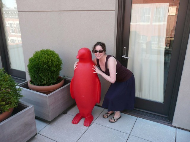 Stephanie Block on her balcony at 21C Hotel with red penguin