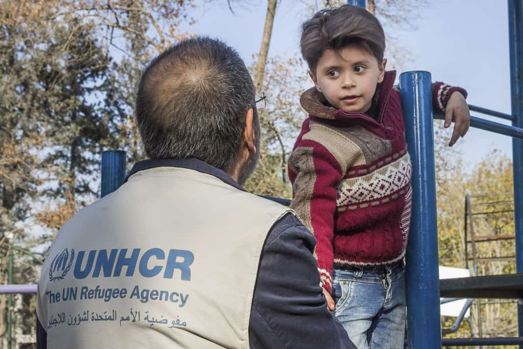 UNHCR Head of sub office, Jorge De la Mota meeting with some of the kids who are playing in the park.