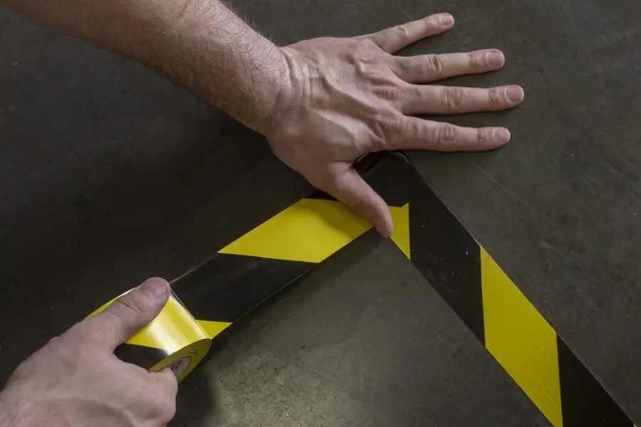 How is tape used to promote safety?
