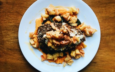 Baked Cinnamon Walnut Chicken, Topped with Melted Brie, Sautéed Apples and Vanilla Honey, Over a Bed of Greens & Butternut Squash Puree