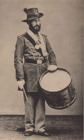 Military drummer. Taps may have been derived by a drumbeat sequence sounded at the end of the day.