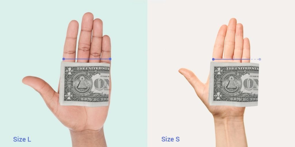 Image of a folded dollar bill resting on top of a palm where the width of the fingers and palm is less than the width of the folded bill and where it is wider than the bill.