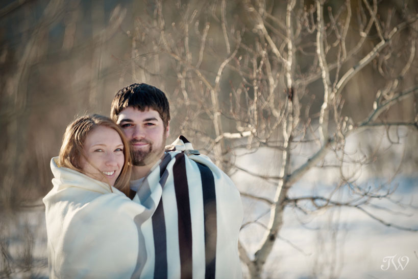 couple in a Hudson Bay Blanket during their winter engagement session