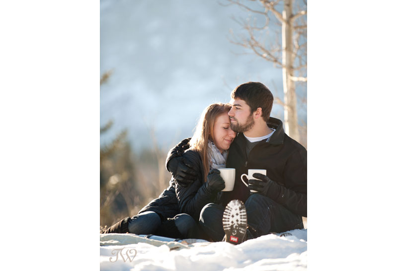 couple sip hot chocolate during their engagement session captured by Tara Whittaker