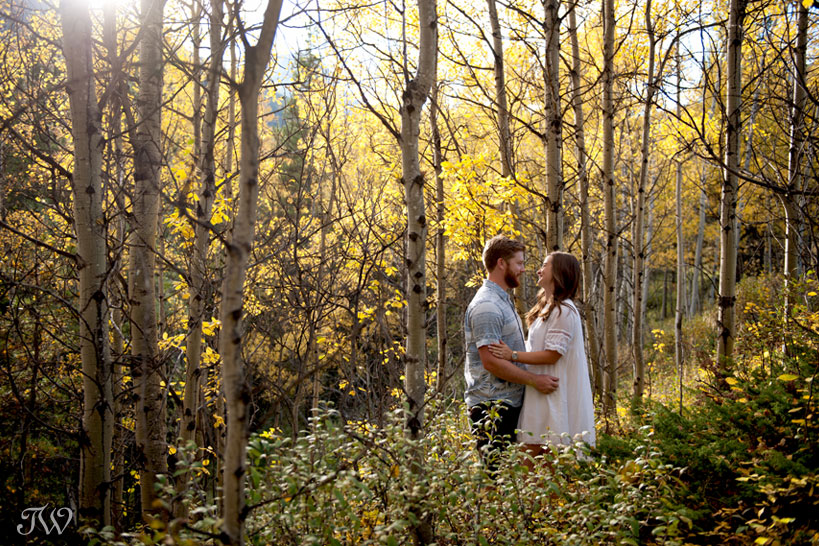 couple amongst the yellow trees during their fall engagement session