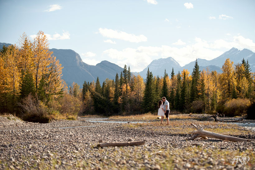 couple beside the Kananaskis River captured by Calgary wedding photographer Tara Whittaker