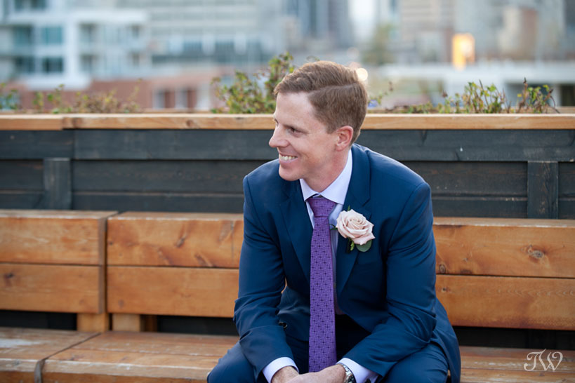 Groom on the rooftop patio at Charbar in the East Village Calgary