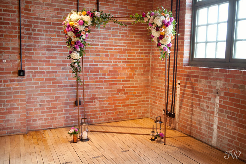 Copper wedding arch from Rus Vintage and Flowers by Janie captured by Tara Whittaker