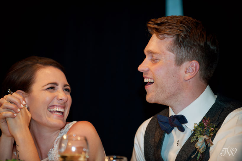 Bride and groom during wedding reception at Cornerstone Theatre in Canmore