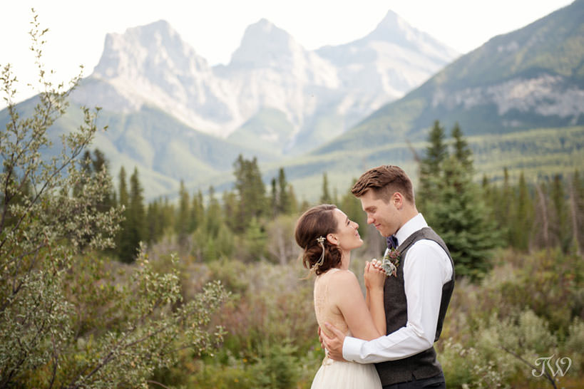 Bride and Groom with The Three Sisters in Canmore captured by Tara Whittaker Photography
