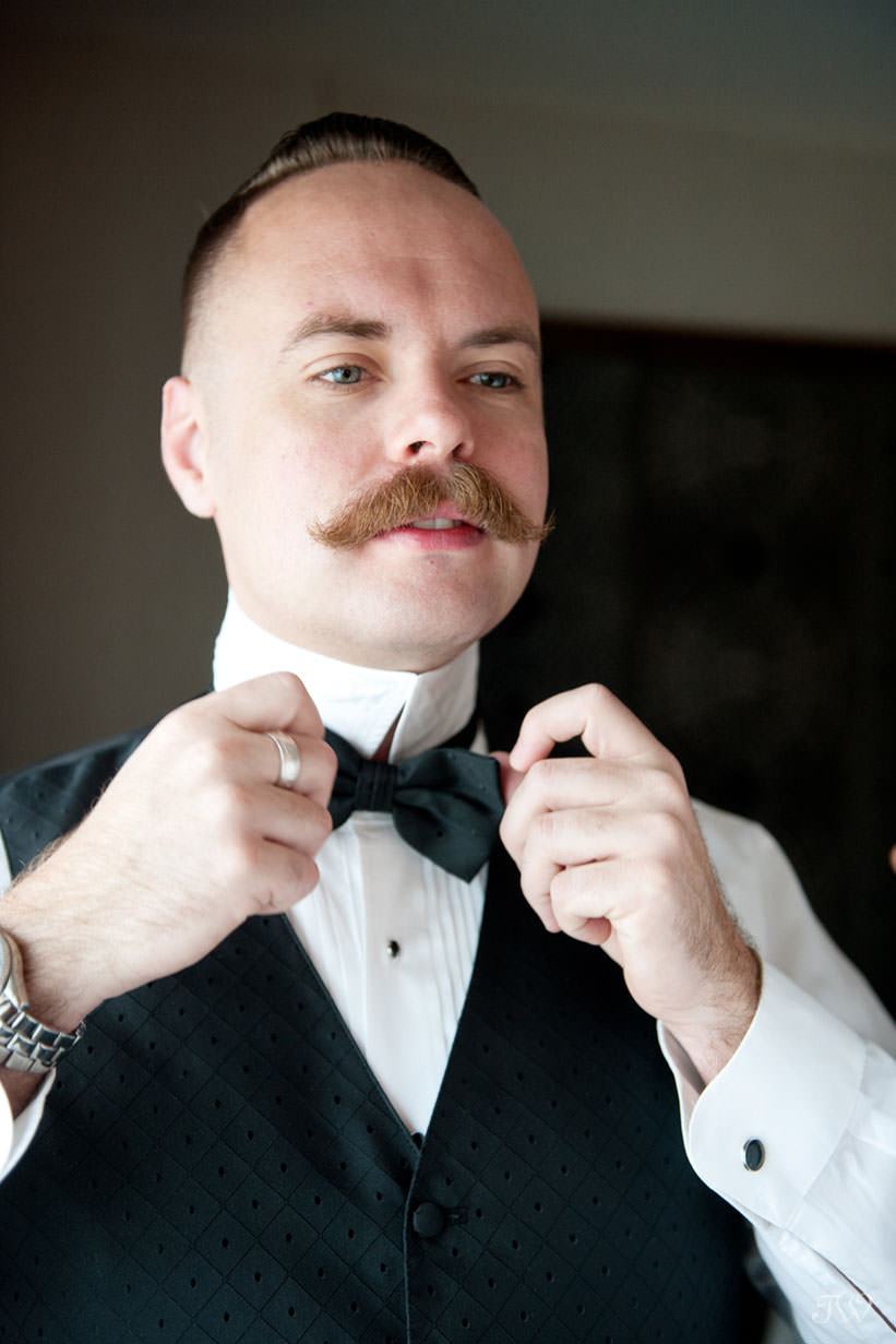 groom getting ready for his Lake House wedding captured by Calgary wedding photographer Tara Whittaker