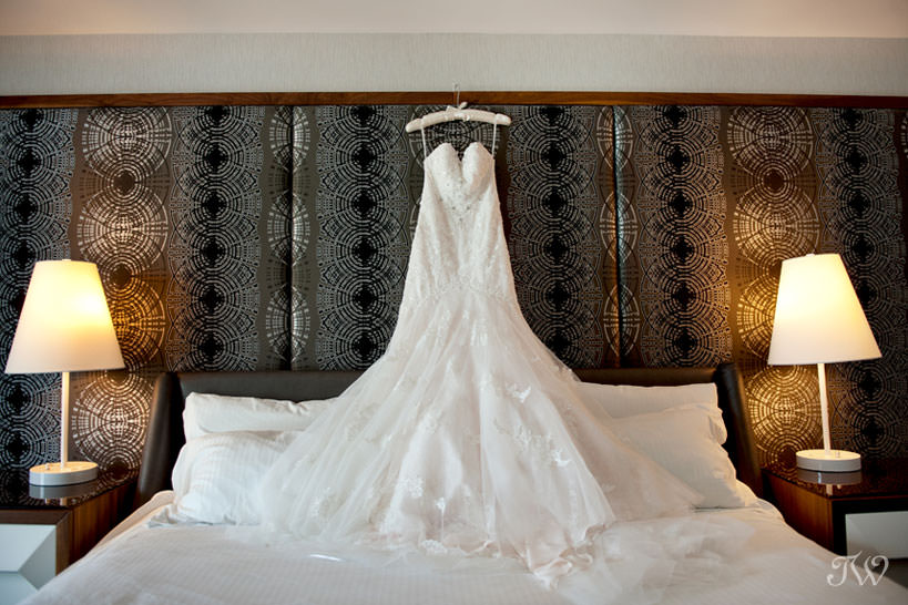 Bride's gown before her Lake House wedding captured by Calgary wedding photographer Tara Whittaker
