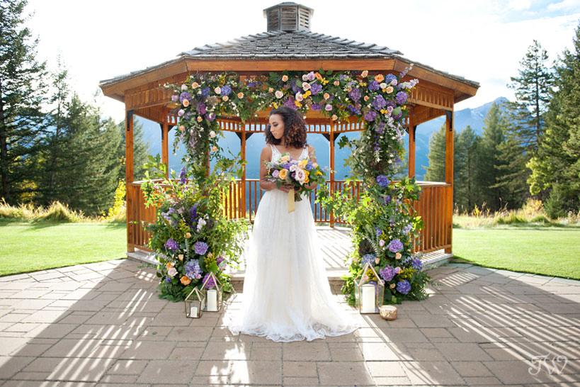 bride at the Silvertip wedding gazebo captured by Calgary wedding photographer Tara Whittaker
