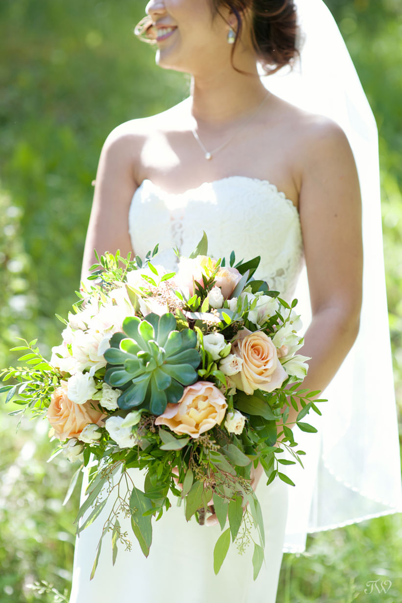 Summer bride carries succulents in this feature of best bridal bouquets by Tara Whittaker Photography